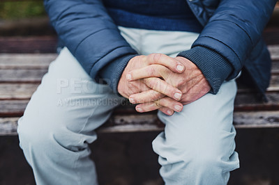 Buy stock photo Cropped shot of a senior man's hands sitting on a park bench