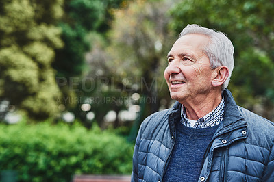 Buy stock photo Shot of a happy senior man enjoying a day in the park