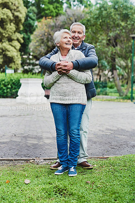 Buy stock photo Shot of an affectionate senior couple spending the day together in a park