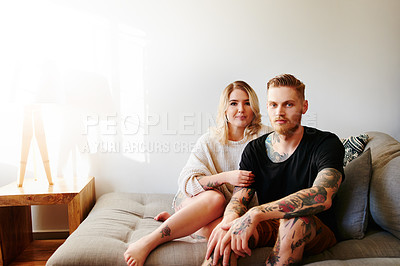 Buy stock photo Portrait of a young couple relaxing at home