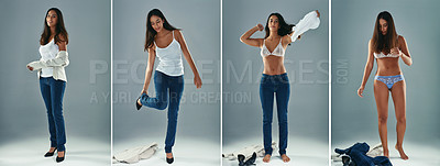 Buy stock photo Studio shot of a beautiful young woman getting undressed against a gray background