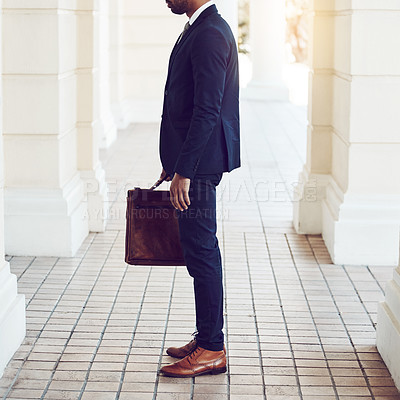 Buy stock photo Cropped shot of a stylishly dressed businessman in the city