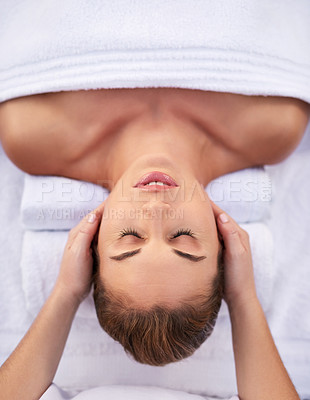 Buy stock photo Cropped shot of a young woman getting a head massage at a day spa