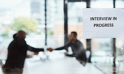 Buy stock photo Defocused shot of businesspeople shaking hands during an interview in an office