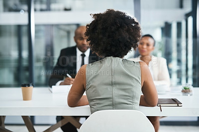 Buy stock photo Rearview shot of a businesswoman being interviewed in an office