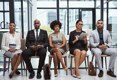 Buy stock photo Portrait of a group of businesspeople waiting in line in an office
