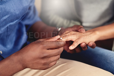 Buy stock photo Cropped shot of an unrecognizable couple getting engaged