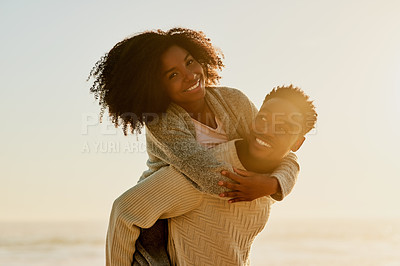 Buy stock photo Shot of an affectionate young couple on the beach