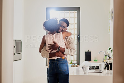 Buy stock photo Shot of an affectionate couple spending quality time at home