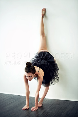 Buy stock photo Full length shot of an attractive young female interpretive dancer practicing in her dance studio