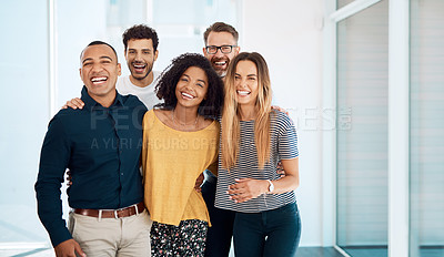 Buy stock photo Cropped portrait of a group of creative businesspeople standing together in their modern office