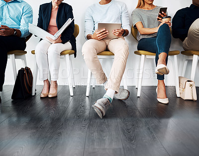 Buy stock photo Cropped shot of a group of unrecognizable creative businesspeople sitting in line waiting for their interviews