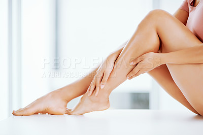 Buy stock photo Low angle shot of a young woman's bare legs