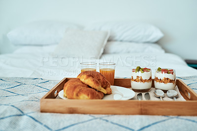 Buy stock photo Cropped shot of a healthy breakfast on a serving tray on a bed