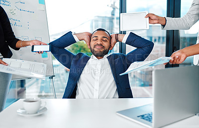 Buy stock photo Shot of a young businessman looking calm in a demanding office environment