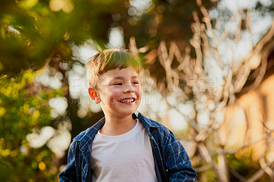 Buy stock photo Cropped shot of an adorable little boy spending the day outside