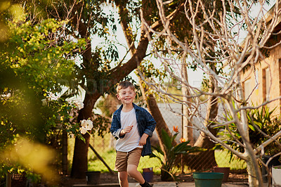 Buy stock photo Cropped shot of an adorable little boy playing outside
