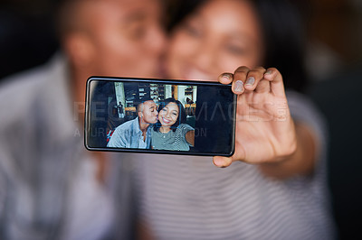 Buy stock photo Shot of a young couple taking a selfie on a date in a cafe