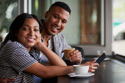 Buy stock photo Portrait of a young couple using a mobile phone together on a date in a cafe