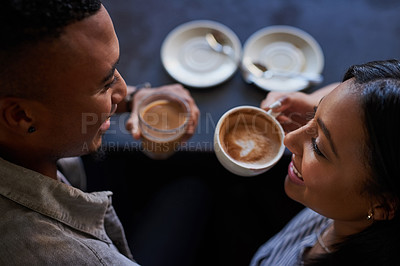 Buy stock photo High angle shot of a young couple having coffee on a date in a cafe