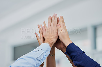 Buy stock photo Closeup shot of a group of businesspeople high fiving together in an office