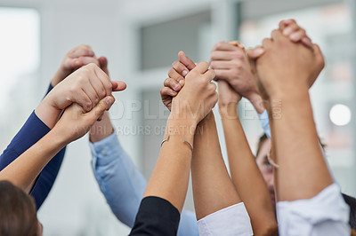 Buy stock photo Closeup shot of a group of businesspeople holding their hands together in solidarity