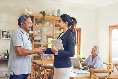 Buy stock photo Shot of a mature couple meeting with their financial consultant at home