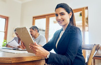Buy stock photo Portrait of a young consultant meeting with a mature couple at their home