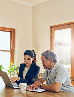Buy stock photo Shot of a mature man getting advice from a financial consultant at home