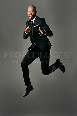 Buy stock photo Studio portrait of a handsome young businessman against a gray background