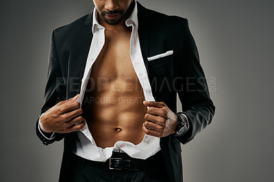 Buy stock photo Studio shot of a stylish and sexy unrecognizable businessman against a gray background