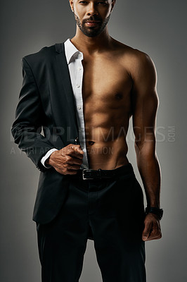 Buy stock photo Studio portrait of a stylish and sexy businessman against a gray background