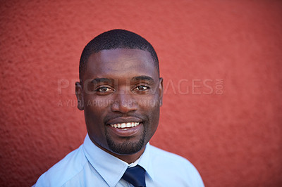 Buy stock photo Portrait of a young businessman standing against a red wall outdoors