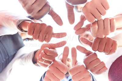 Buy stock photo Closeup shot of a group of unrecognizable businesspeople showing thumbs up outdoors