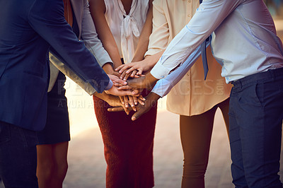 Buy stock photo Closeup shot of an unrecognizable group of businesspeople joining their hands together in unity