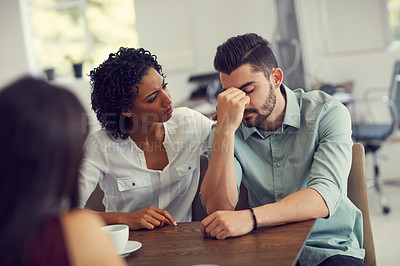 Buy stock photo Cropped shot of a wife consoling her husband during a counselling session with a therapist