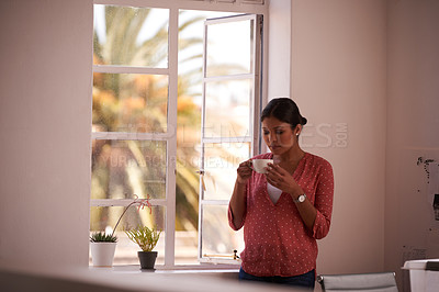 Buy stock photo Shot of a young businesswoman having a coffee break in a modern office