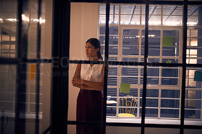 Buy stock photo Shot of a young businesswoman looking anxious in an office