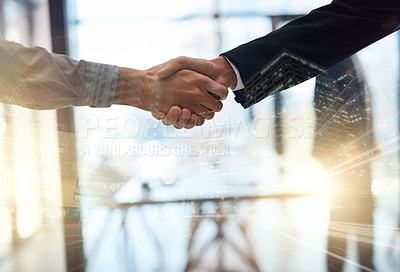Buy stock photo Closeup shot of businesspeople shaking hands in an office superimposed over a cityscape