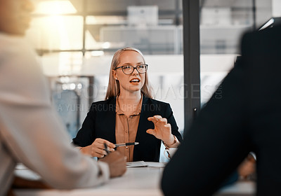 Buy stock photo Shot of a young businesswoman having a meeting with her colleagues in a office