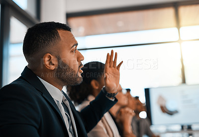 Buy stock photo Shot of a young businessman raising his hand during a meeting in an office