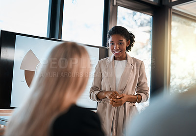 Buy stock photo Shot of a young businesswoman giving a presentation to a colleague in an office