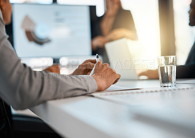Buy stock photo Closeup shot of unrecognizable businesspeople having a meeting in an office
