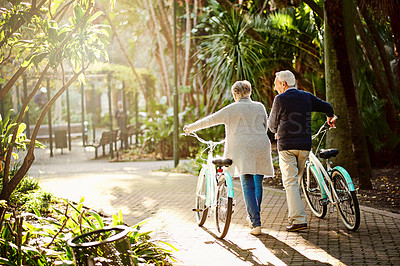 Buy stock photo Shot of a senior couple out in the park with their bicycles