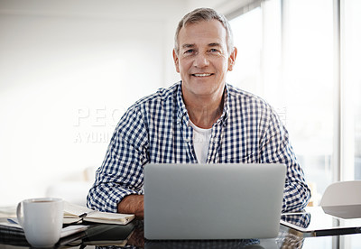 Buy stock photo Portrait of a mature man working on a laptop at home