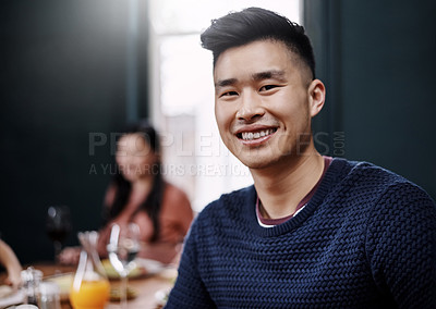 Buy stock photo Portrait of a handsome young man having a meal with his wife at home