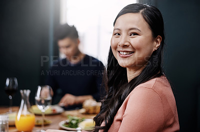 Buy stock photo Portrait of a beautiful young woman having a meal with her husband at home