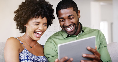 Buy stock photo Cropped shot of a young married couple using a tablet together at home