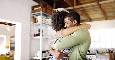 Buy stock photo Cropped shot of young married couple embracing each other at home