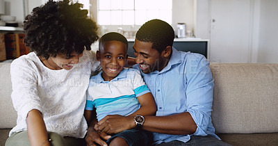 Buy stock photo Cropped shot of a young family chilling on the sofa together in the living room at home